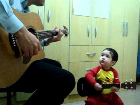 2-Year-Old Boy And His Dad Perform The Beatles' 'Don't Let