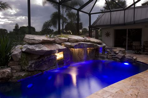 Siesta Key Pool Remodel with Stone Grotto Waterfall and