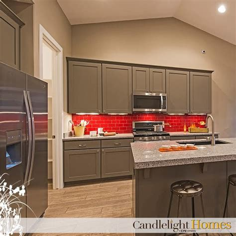 Colorful red backsplash and grey cabinets