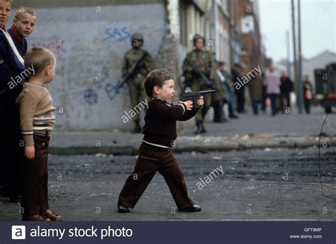Kids playing guns, during The Troubles Belfast Northern